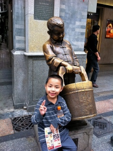 A break from shopping in Guangzhou, and a smile.